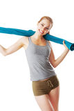Sporty woman holding blue towel and smiling after workout. Isolated on white Royalty Free Stock Images