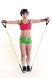 Sporty woman holding a exercise band in both hands. Image of a fit female with resistance band Stock Photography