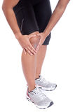 Sporty woman holding her injured knee Royalty Free Stock Photography