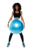 Sporty woman holding pilate ball Stock Image