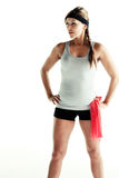Sporty woman holding resistance band Royalty Free Stock Images