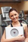 Sporty woman holding a scale Stock Photo