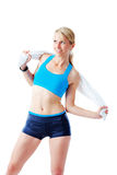 Sporty woman holding a towel around her back Royalty Free Stock Image