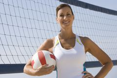 Sporty Woman Holding Volleyball Royalty Free Stock Image