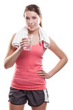 Sporty woman holding water Stock Images