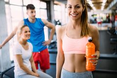 Sporty woman hydrating during workout. Sporty women hydrating during workout in gym royalty free stock photo