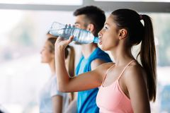 Sporty woman hydrating during workout. Sporty women hydrating during workout in gym royalty free stock photos