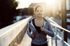 Sporty woman jogging in city Stock Photography