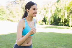 Sporty woman jogging while listening music Royalty Free Stock Photo