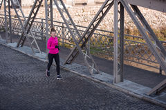 Sporty woman jogging on morning Stock Images