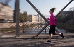 Sporty woman jogging on morning Royalty Free Stock Photography