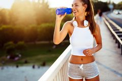 Sporty woman jogging outdoors royalty free stock image
