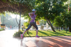 Sporty woman jogging Royalty Free Stock Image