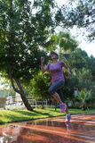 Sporty woman jogging Royalty Free Stock Photography