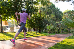 Sporty woman jogging Royalty Free Stock Images