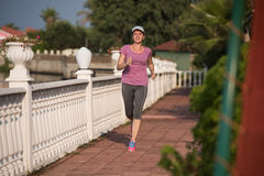 Sporty woman jogging Royalty Free Stock Photos