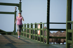 Sporty woman jogging Stock Images