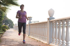 Sporty woman jogging Stock Image