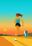 Sporty woman jogs in the evening Royalty Free Stock Photography