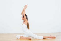Sporty woman with joined hands over head at a fitness studio Royalty Free Stock Photos