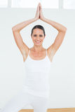 Sporty woman with joined hands over head at a fitness studio Royalty Free Stock Images