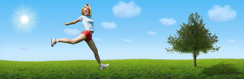 Sporty woman jump on landscape Royalty Free Stock Photography