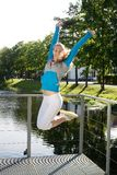 Sporty woman jump outdoor Royalty Free Stock Photography