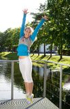 Sporty woman jump outdoor Stock Photography