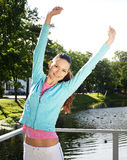 Sporty woman jump outdoor Royalty Free Stock Image
