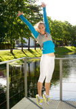 Sporty woman jump outdoor Stock Photo