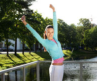 Sporty woman jump outdoor Royalty Free Stock Photos