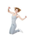 Sporty woman jumping with joy Royalty Free Stock Images