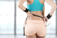 Sporty Woman With Jumping Rope. Back of sporty woman with a jumping rope, in a gym Stock Photos