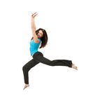 Sporty woman jumping in sportswear Royalty Free Stock Image