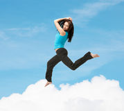 Sporty woman jumping in sportswear Stock Photography