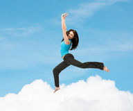 Sporty woman jumping in sportswear Royalty Free Stock Images