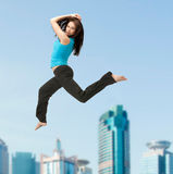 Sporty woman jumping in sportswear Stock Photos