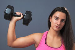 Sporty Woman Lifting Dumbbell Stock Images