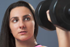 Sporty Woman Lifting Dumbbell Royalty Free Stock Image