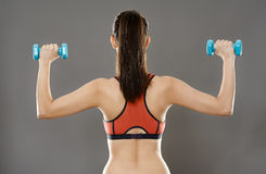 Sporty woman lifting dumbbells Stock Photography
