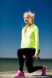 Sporty woman with light dumbbells outdoors Stock Image