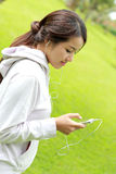 Sporty woman listening music from her smartphone Stock Image