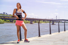 Sporty woman listening music before running. Female athlete list. Ening music while doing sport Stock Photography