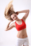 Sporty woman with long blowing hair over white Stock Photo
