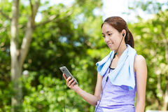 Sporty woman look at the cellphone with earphone Stock Photography