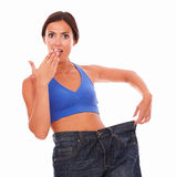 Sporty woman looking surprised on weight loss Royalty Free Stock Photo