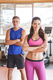 Sporty woman and man with armcrossed at the gym Stock Image