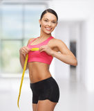 Sporty woman measuring her breast Stock Images