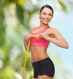 Sporty woman measuring her breast Royalty Free Stock Photography