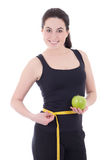 Sporty woman measuring her waist and holding apple isolated on w Stock Photography